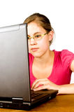 Actractive female studying behind a laptop Stock Photo