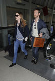 Actress Anne Hathaway & boyfriend at LAX airport Stock Photography