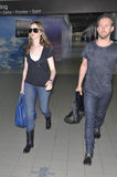 Actress Anne Hathaway and boyfriend at LAX airport. LOS ANGELES-APRIL 4: Actress Anne Hathaway and boyfriend at LAX airport. April 4 in Los Angeles, California Royalty Free Stock Photos