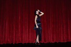 The actress appears on stage in a black dress Royalty Free Stock Image