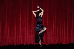 The actress appears on stage in a black dress Royalty Free Stock Photos