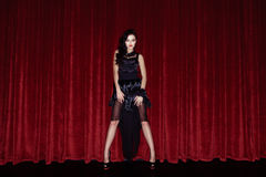 The actress appears on stage in a black dress Royalty Free Stock Images