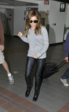 Actress Ashley Tisdale at LAX airport. LOS ANGELES-APRIL 15: Actress Ashley Tisdale at LAX airport. April 15 in Los Angeles, California 2011 Stock Images