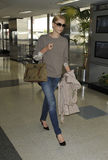 Actress Charlise Theron is seen at LAX Royalty Free Stock Image