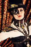 Actress cinems. Portrait of a beautiful steampunk woman over vintage background Stock Photography