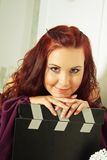 Actress with clapper board Royalty Free Stock Image