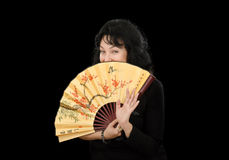 Actress covers her face with Japanese fan Royalty Free Stock Photos
