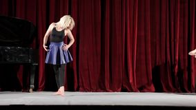 Actress dancing on the scene of a theatre. And two musicians playing stock video footage