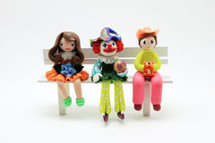 Actress 3 dolls on a chair Stock Photos