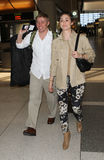 Actress Emmy Rossum & boyfriend Tyler Jacob at LAX Royalty Free Stock Images