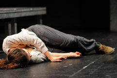An actress, in the floor after being poisoned, of the Barcelona Theater Institute Stock Photos