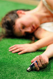 An actress, in the floor after being poisoned, of the Barcelona Theater Institute. BARCELONA - JAN 13: An actress, in the floor after being poisoned, of the Stock Photos
