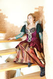 Actress  in medieval dress sitting on stairs Royalty Free Stock Image
