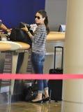 Actress Mila Kunis at LAX airport. LOS ANGELES-AUGUST 29: Actress Mila Kunis at LAX airport. August 29 in Los Angeles, California 2011 Stock Image