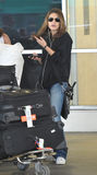 Actress Mila Kunis is seen at LAX . Royalty Free Stock Image