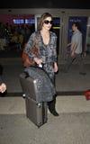 Actress Milla Jovovich at LAX airport Stock Photo