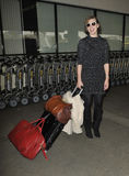 Actress Milla Jovovich is seen at LAX airport Stock Photos