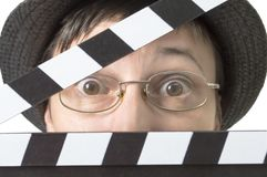 Actress with movie clapper behind face. stock images