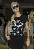Actress Paris Hilton is seen at LAX Stock Photo