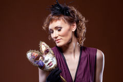 Actress posing with mask. Concept of Two-Face. Royalty Free Stock Photos