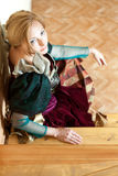 Actress posing in medieval dress sitting on stairs Stock Image