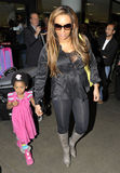 Actress/spice girl Melanie Brown aka Mel B at LAX. LOS ANGELES-APRIL 15: Actress/singer/ex spice girl Melanie Brown aka Mel B with daughter at LAX airport. April Royalty Free Stock Photography