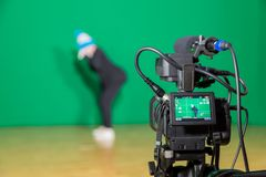 Actress in theatrical costume in a television Studio. Green screen and chroma key. Lighting equipment and filming equipment.  stock images
