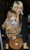 Actress Tori Spelling with daughter at LAX airport. LOS ANGELES-APRIL 8: Famous sibling ,daughter of Aaron Spelling , actress Tori Spelling with daughter at LAX Royalty Free Stock Image