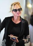 Actrice Melanie Griffith à l'aéroport de LAX, CA Etats-Unis Image libre de droits