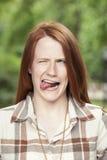 Actuación adolescente tonto con la expresión Fotos de archivo libres de regalías