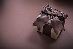 Actual caja en concepto superficial marrón de los días de fiesta Imagenes de archivo