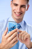 Actual future innovative ideas  - Young man with transparent fut. Young man with transparent futuristic phone, concept actual future innovative ideas and best Stock Photos