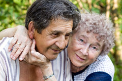 Actual gladness of elderly people. Hugging stock photo