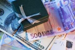 Actuales caja y dinero - dólar y euro Imagen de archivo libre de regalías
