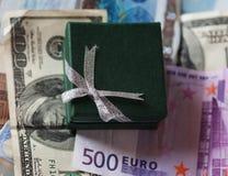 Actuales caja y dinero - dólar y euro Fotografía de archivo libre de regalías