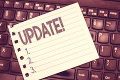 Actualización de la escritura del texto de la escritura El significar del concepto actualizado hace algo una versión más reciente imagenes de archivo