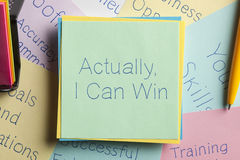 Actually, I Can Win written on a note. Top view of Actually, I Can Win written on a note with a pen aside Royalty Free Stock Photos