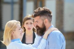 It actually makes her jealous. Unhappy woman feeling jealous. Jealous girl look at couple in love on street. Romantic stock photography