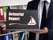 Actuarial Report phrase on laptop