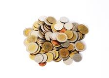 Acuñe la moneda con cierre para arriba en el fondo blanco foto de archivo libre de regalías