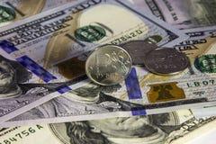 Acuñe una rublo y el europeo y la moneda de los E.E.U.U. fotos de archivo libres de regalías