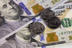 Acuñe una rublo y el europeo y la moneda de los E.E.U.U. Imágenes de archivo libres de regalías