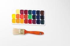 Acuarelas y cepillo Fotografía de archivo libre de regalías