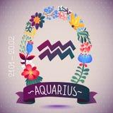 ACUARIO de la muestra del zodiaco, en una guirnalda floral dulce Muestra, flores, hojas y cinta del horóscopo Foto de archivo libre de regalías