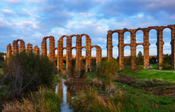 Acueducto de los Milagros - Roman aqueduct. Merida. Evening dusk view of Acueducto de los Milagros - Roman aqueduct. Merida, Spain Royalty Free Stock Images
