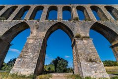 Acueducto de los Pegoes in Portugal. Ancient aqueduct located in the city of Tomar, which supplied water to the Convent of Christ royalty free stock photo
