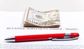 Acuerdo del criado con los dólares y la pluma Foto de archivo libre de regalías
