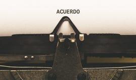 Acuerdo, texte espagnol pour l'accord sur le type auteur de vintage de Image stock