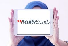 Acuity Brands logo. Logo of Acuity Brands on samsung tablet holded by arab muslim woman. Acuity Brands is an electronics manufacturing company Stock Image