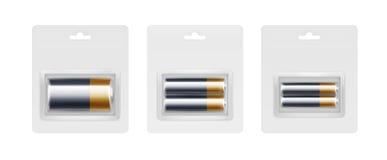 Acumuladores alcalinos de oro amarillos negros en embalado Imágenes de archivo libres de regalías